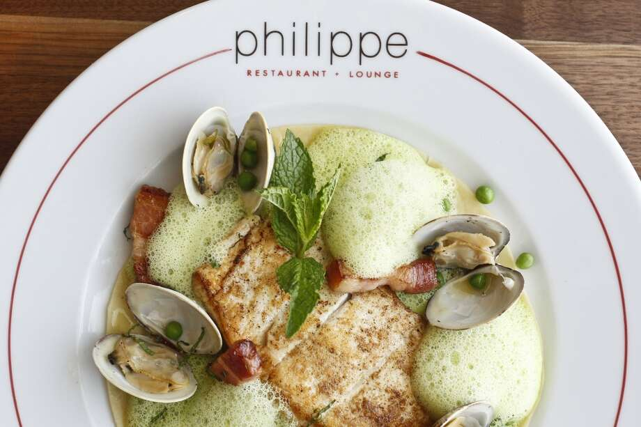 Pan-seared Halibat on a bed of Lasagna with Sweet Pea and Mint Emulsion, Clams and Lardon, at Philippe restaurant.  (Michael Paulsen / Houston Chronicle Photo: Michael Paulsen, Houston Chronicle