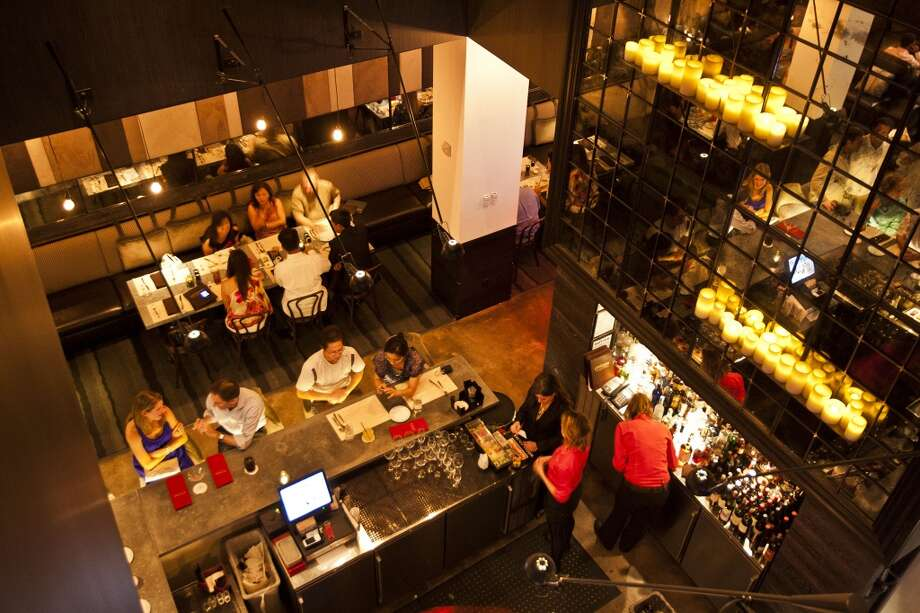 An overhead view of bar at Philippe Restaurant and Lounge at 1800 Post Oak Blvd. ( Patrick T. Fallon / Houston Chronicle ) Photo: Patrick T Fallon, Houston Chronicle