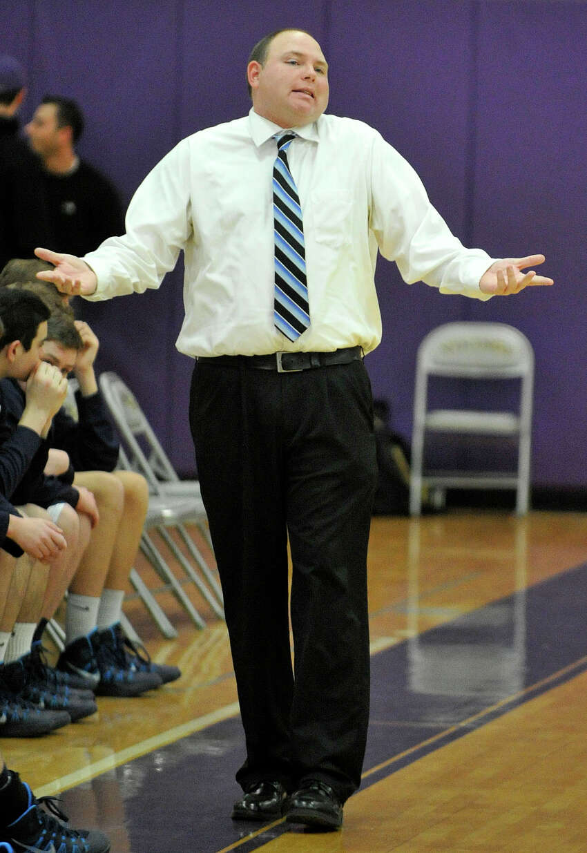 Wilton head coach Joel Geriak motions to his team on the court during their basketball game against Westhill at Westhill High School in Stamford, Conn., on Monday, Jan. 6, 2014. Westhill won, 51-43.