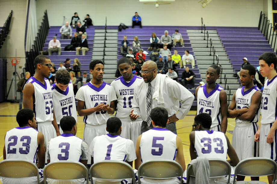 Westhill head coach Howard White talks to his team between quarters during their basketball game against Wilton at Westhill High School in Stamford, Conn., on Monday, Jan. 6, 2014. Westhill won, 51-43. Photo: Jason Rearick / Stamford Advocate