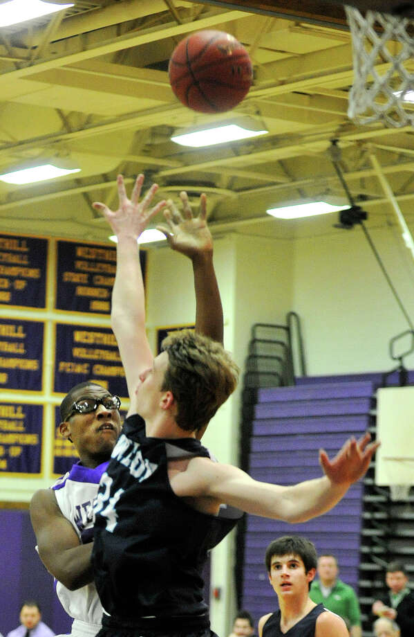 Westhill's Chianta' Holtzclaw shoots over Wilton's Peter Ciaccio during their basketball game at Westhill High School in Stamford, Conn., on Monday, Jan. 6, 2014. Westhill won, 51-43. Photo: Jason Rearick / Stamford Advocate