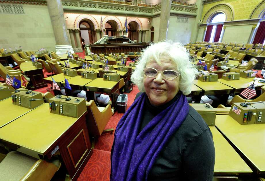 "Cynthia Pooler stands in the Assembly Chamber Tuesday afternoon, Jan. 7, 2014, in Albany, N.Y. Pooler is a 66-year-old state Labor Department clerical worker, who is now part of the Capitol press corps with her blog and podcast service, ""Focus on Albany.""   (Skip Dickstein / Times Union) Photo: SKIP DICKSTEIN / 0025275A"