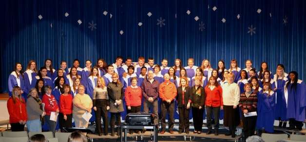 Rensselaer High School Alumni from 1961-83 (front row) joined the current student chorus under the direction of Robyn Sheldon in singing Silver Bells at the school's winter concert on Dec. 11.  This is the first time in the school's 115-year history that alumni participated.  Lynne Beiermeister, president of the newly- formed Alumni Association, is hoping that this will become a lasting tradition for years to come.  Information about the association is available by contacting her at RenssAlum@gmail.com.   (Lynne Beiermeister)