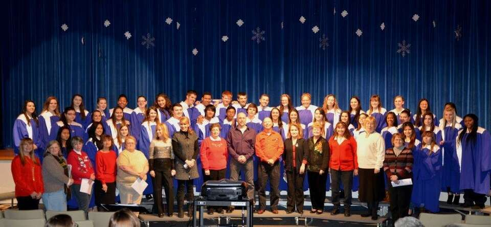 Rensselaer High School Alumni from 1961-83 (front row) joined the current student chorus under the d