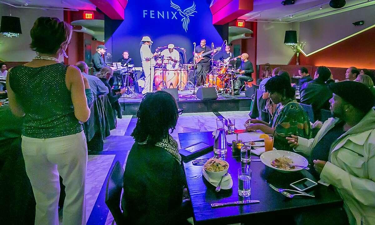 People enjoy dinner listening to music at the Fenix in San Rafael, Calif., on December 20th, 2013.