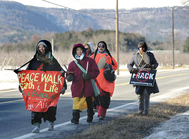 Aniti-fracking marchers, from left, Miki Fukui of Brooklyn, Jun Yasuda, 65-year-old Buddhist nun who founded the Peace Pagoda in Grafton, Sarah Clark of Massachusetts, Yoko Essel of New York City and Andi Feron of Rifton, N.Y. walk along Route 156 on Tuesday, Jan. 7, 2014 in Voorheesville , N.Y. The group is walking 50 miles from Sharon Springs to the Capitol to protest hydrofracking and they'll join an anti-fracking rally Wednesday prior to Gov. Cuomo's State of the State. (Lori Van Buren / Times Union) Photo: Lori Van Buren / 00025277A