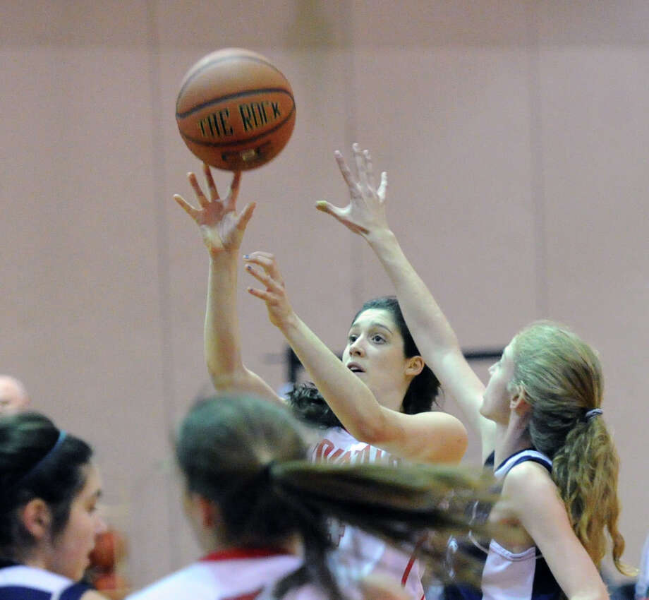 At center, Leigh Galletta of Greenwich gets off a shot during the girls high school basketball game between Greenwich High School and Staples High School at Greenwich, Tuesday, Jan. 7, 2014. Photo: Bob Luckey / Greenwich Time
