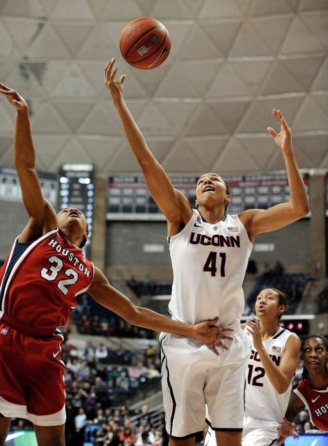 Connecticut's Kiah Stokes (41) reaches for a rebound over Houston's Te'onna Campbell (32) during the first half of an NCAA college basketball game, Tuesday, Jan. 7, 2014, in Storrs, Conn. Photo: Jessica Hill, AP / FR125654 AP