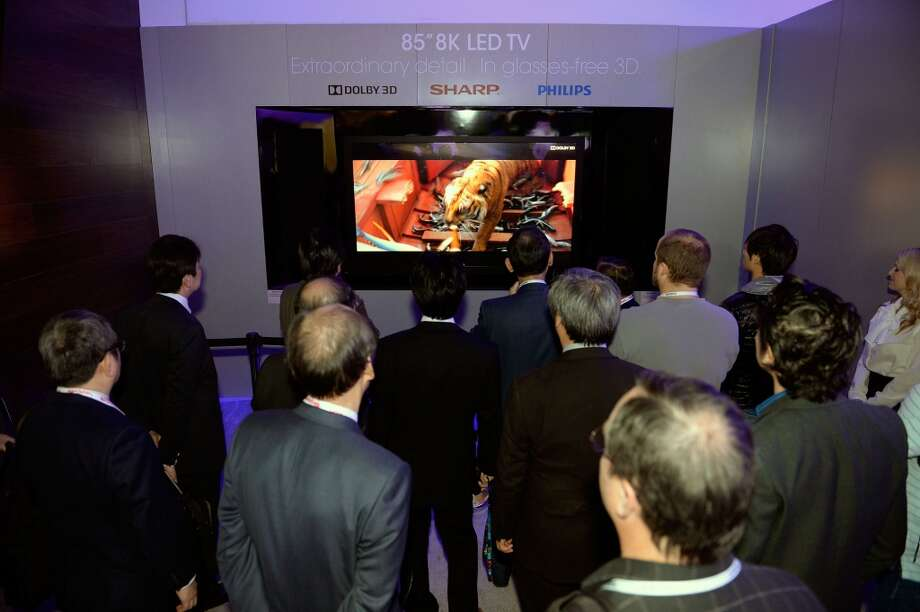 Attendees view Sharp's 85-inch 8K glasses-free 3D television, in partnership with Phillips and Dolby. Photo: Jeff Bottari, Associated Press