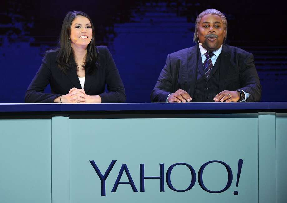 Saturday Night Live members Cecily Strong and Kenan Thompson perform a SNL Weekend Update sketch during Marissa Mayer's keynote address. Mayer announced a partnership with Saturday Night Live for exclusive clips via Yahoo videos. Photo: ROBYN BECK, AFP/Getty Images