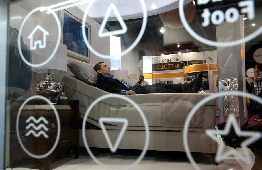 "A Sleep Number representative lays on the new Sleep Number X12 bed. This ""smart bed"" monitors sleeping habits and offers suggestions for improvements. Photo: Justin Sullivan, Getty Images"
