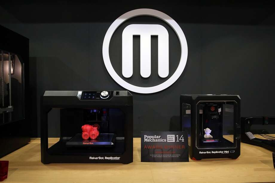 MakerBot 3D printers are displayed in the MakerBot booth. CEO Brett Pettis unveiled a smaller, cheaper printer that costs $1,375. Photo: Justin Sullivan, Getty Images