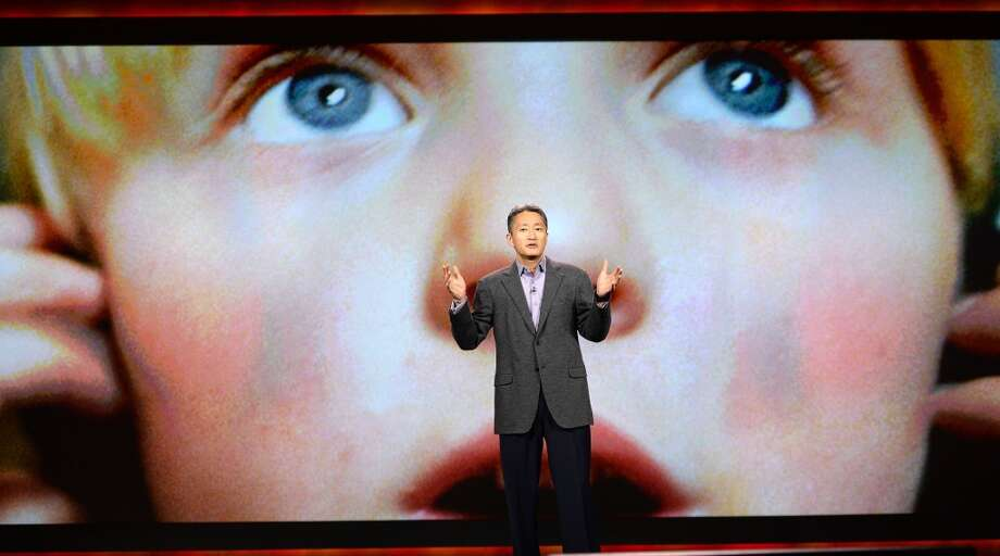 """Sony CEO and President Kazuo Hirai gives his keynote address on the opening day of the 2014 International CES. """"The mission of Sony is to inspire and fulfill people's curiosity around the world,"""" he said. Photo: ROBYN BECK, AFP/Getty Images"""