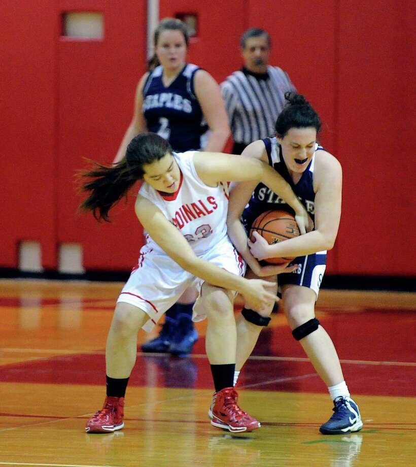 Jamie Kockenmeister (# 23) of Greenwich, left, goes for the ball as it is held by a Staples player during the girls high school basketball game between Greenwich High School and Staples High School at Greenwich, Tuesday, Jan. 7, 2014. Photo: Bob Luckey / Greenwich Time
