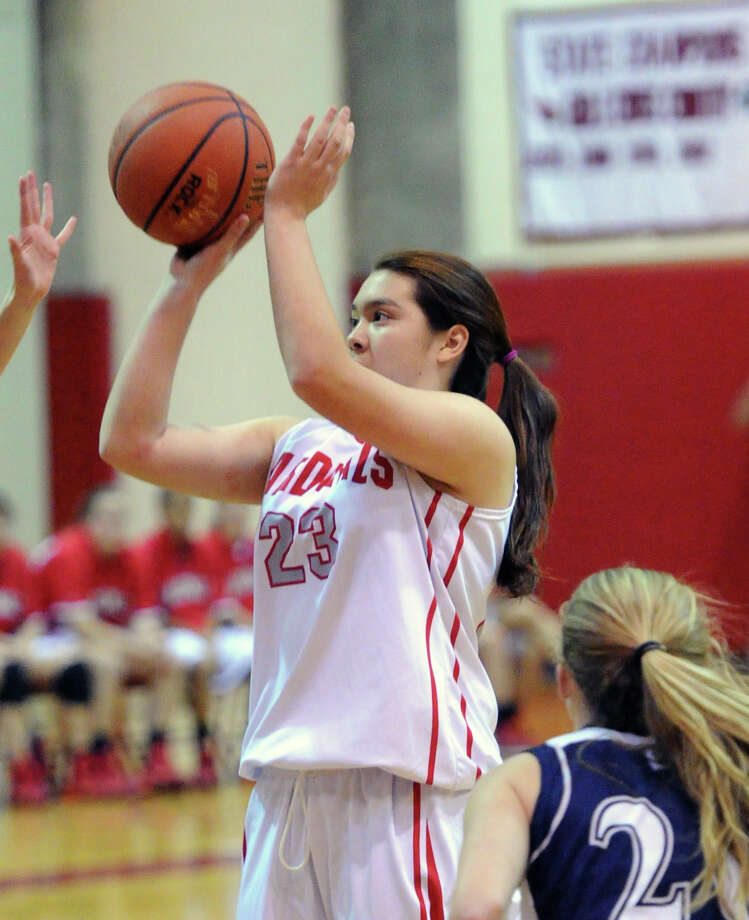 Jamie Kockenmeister (# 23) of Greenwich connects on a jump-shot during the girls high school basketball game between Greenwich High School and Staples High School at Greenwich, Tuesday, Jan. 7, 2014. Photo: Bob Luckey / Greenwich Time