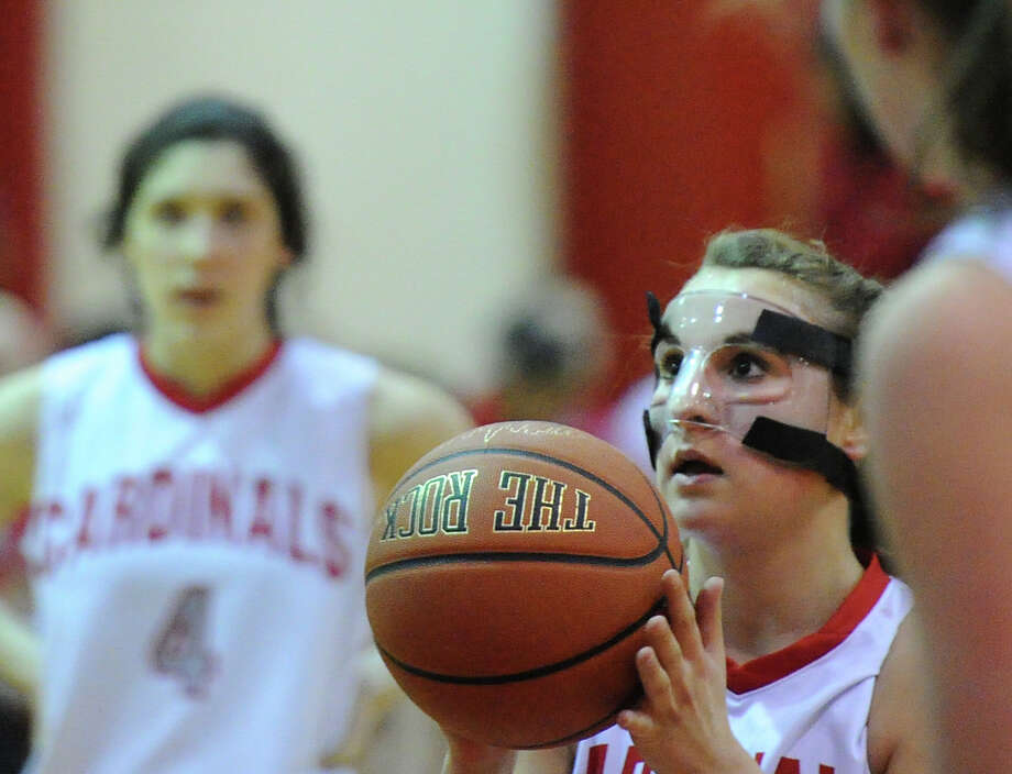 Alexa Moses of Greenwich, at center, shoots a foul shot during the girls high school basketball game between Greenwich High School and Staples High School at Greenwich, Tuesday, Jan. 7, 2014. Photo: Bob Luckey / Greenwich Time