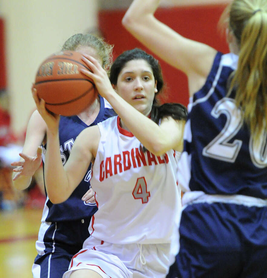 At center, Leigh Galletta (#4) of Greenwich passes during the girls high school basketball game between Greenwich High School and Staples High School at Greenwich, Tuesday, Jan. 7, 2014. Photo: Bob Luckey / Greenwich Time