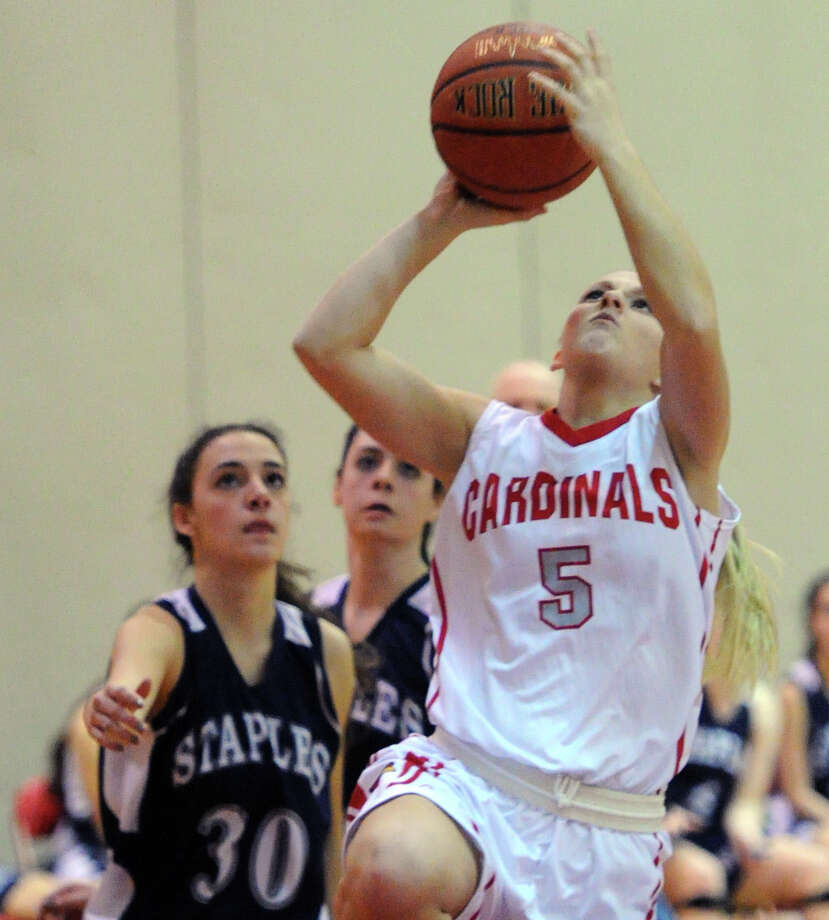 At right, Rebecca DeCarlo (#5) of Greenwich drives past Sarah Mahoney (# 30) of Staples to score a basket during the girls high school basketball game between Greenwich High School and Staples High School at Greenwich, Tuesday, Jan. 7, 2014. Photo: Bob Luckey / Greenwich Time
