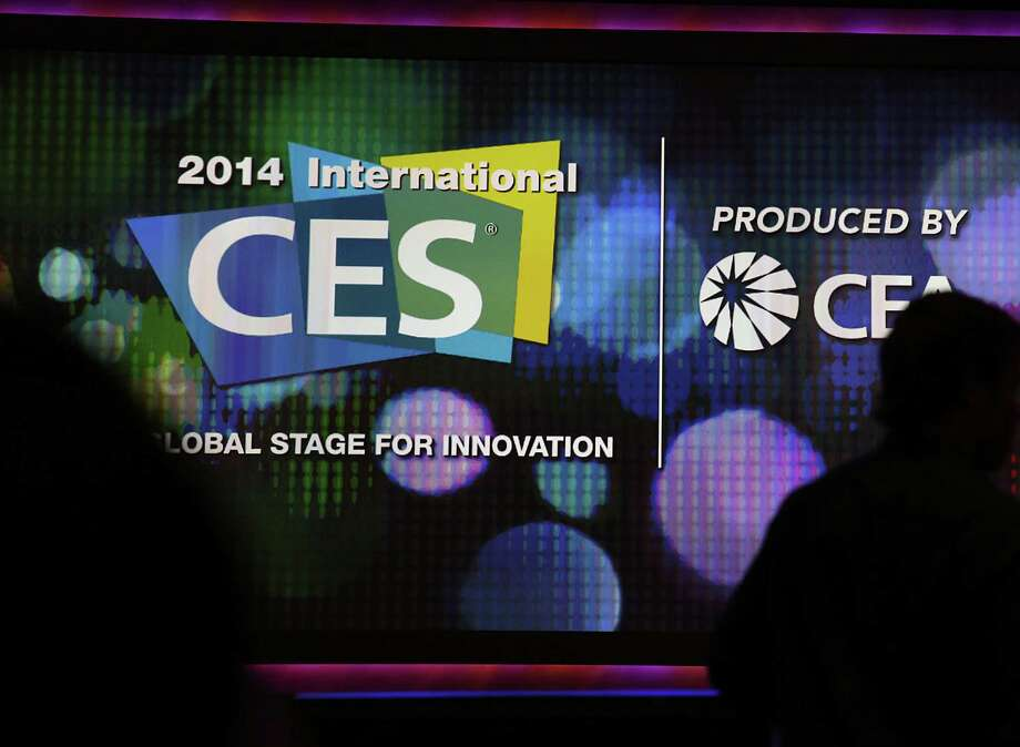 Silhouettes of attendees are seen arriving for the Sony Corp. keynote speech during a news conference at the 2014 Consumer Electronics Show (CES) Tuesday in Las Vegas. Photo: Patrick T. Fallon / Bloomberg / © 2014 Bloomberg Finance LP