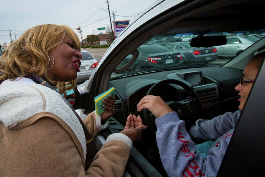 Cynthia Hicks takes donations Monday on West­heimer. The city requires solicitors to obtain permits, an idea Harris County Sheriff Adrian Garcia supports. Photo: Marie D. De Jesus, Staff / © 2014 Houston Chronicle