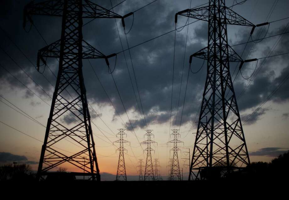 The demand of 57,277 megawatts in the hour ending at 8 a.m. Tuesday exceeded the previous winter record of 57,265 megawatts on Feb. 10, 2011, days after the state's last rolling blackouts, the Electric Reliability Council of Texas reports. Photo: Allison V. Smith, The New York Times / NYTNS