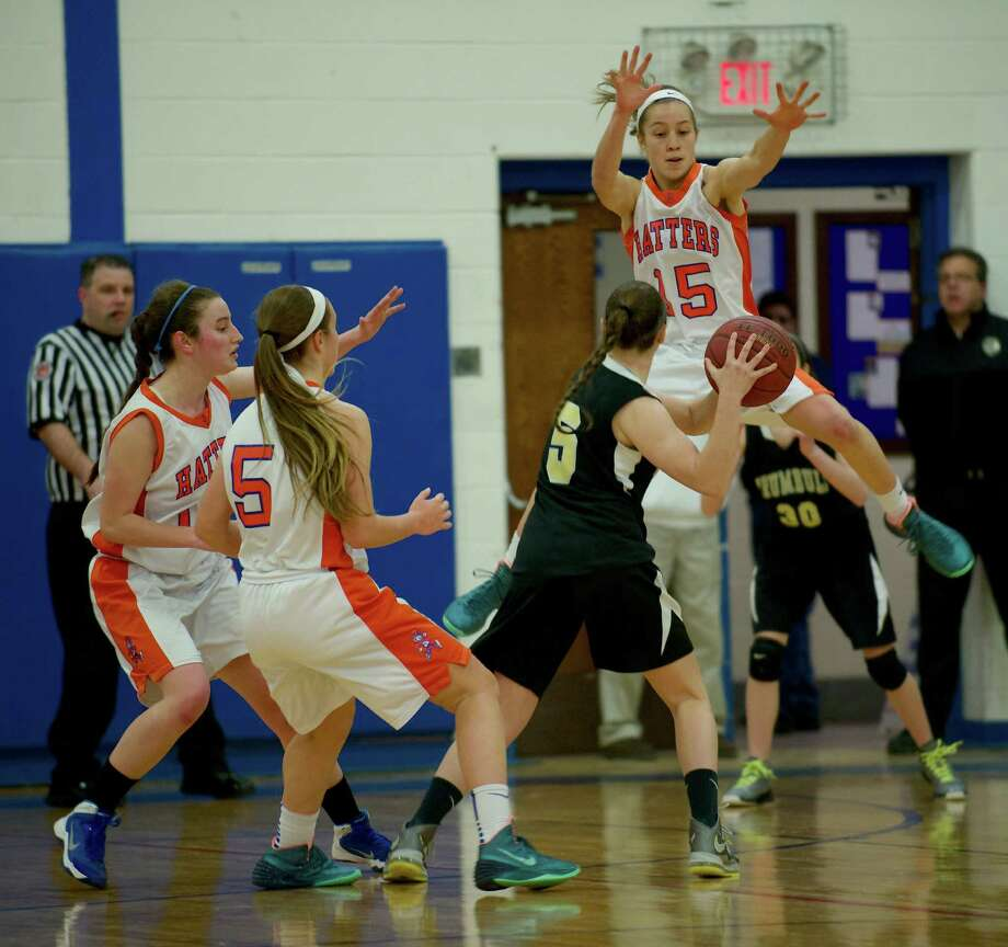Danbury's Rebecca Gartner (15) jumps to block a pass by Trumbull's Maggie Parisi (5) during the Trumbull vs. Danbury girls FCIAC basketball game, at Danbury High School in Danbury, Conn, on Tuesday, January 7, 2014. Danbury's Shannon Geary (10) and Rachel Gartner (5) box her in. Photo: H John Voorhees III / The News-Times Freelance
