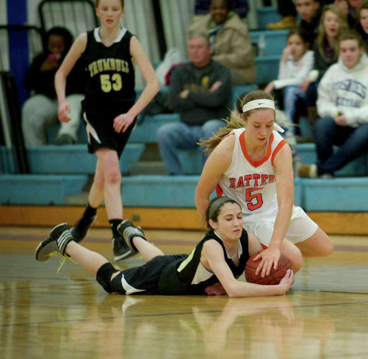 Trumbull's Victoria Ray (30) and Danbury's Rachel Gartner (5) fight for the ball during the Trumbull vs. Danbury girls FCIAC basketball game, at Danbury High School in Danbury, Conn, on Tuesday, January 7, 2014.