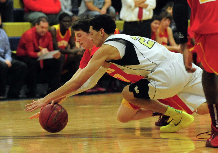 Notre Dame of Fairfield's Raphael Torres, in front, and Stratford's Even Velleca, go after a loose ball, during boys basketball action in Fairfield, Conn. on Tuesday January 7, 2014. Photo: Christian Abraham / Connecticut Post