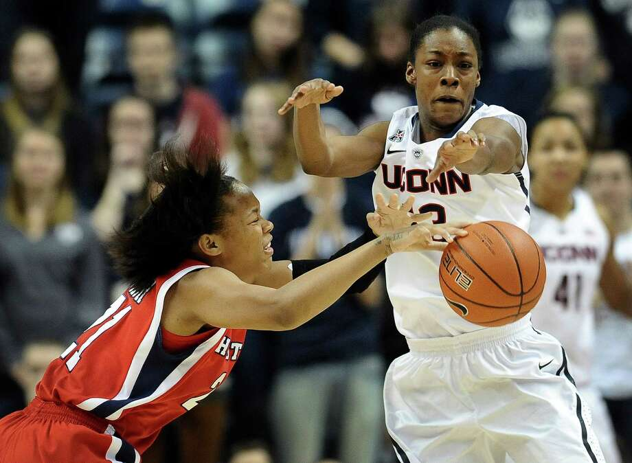 Connecticut's Brianna Banks, right, steals the ball form Houston's Jessieka Palmer during the first half of an NCAA college basketball game, Tuesday, Jan. 7, 2014, in Storrs, Conn. Connecticut won 90-40. (AP Photo/Jessica Hill) Photo: Jessica Hill, Associated Press / FR125654 AP