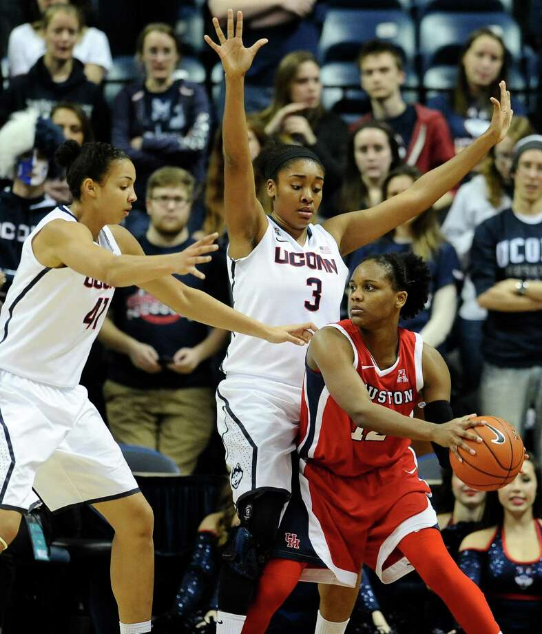 Houston's Destini Texada is pressured by Connecticut's Kiah Stokes, left, and Morgan Tuck, center, during the second half of an NCAA college basketball game, Tuesday, Jan. 7, 2014, in Storrs, Conn. Connecticut won 90-40. (AP Photo/Jessica Hill) Photo: Jessica Hill, Associated Press / FR125654 AP