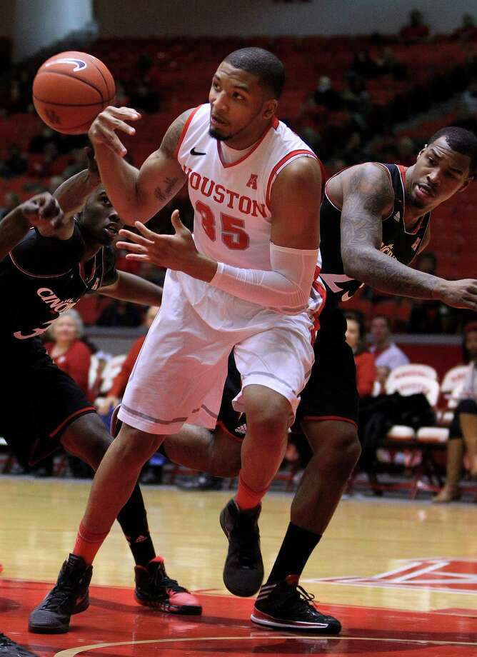 Houston Cougars forward TaShawn Thomas (35) gets the ball stripped from him by Cincinnati Bearcats forward Shaquille Thomas (3) and guard Sean Kilpatrick (23) during the first half of a college basketball game at Hofheinz Pavilion, Tuesday, Jan. 7, 2014, in Houston. Photo: Karen Warren, Houston Chronicle / © 2013 Houston Chronicle