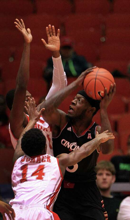 Cincinnati Bearcats forward Justin Jackson (5) attempts to go up for a basket against Houston Cougars Tione Womack (14) and forward Mikhail McLean (1) during the first half of a college basketball game at Hofheinz Pavilion, Tuesday, Jan. 7, 2014, in Houston. Photo: Karen Warren, Houston Chronicle / © 2013 Houston Chronicle