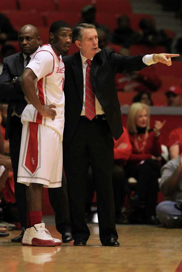 Houston Cougars head coach James Dickey talks with Houston Cougars guard Brandon Morris (2) during the first half of a college basketball game at Hofheinz Pavilion, Tuesday, Jan. 7, 2014, in Houston. Photo: Karen Warren, Houston Chronicle / © 2013 Houston Chronicle