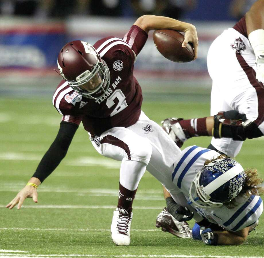 Johnny Manziel may confirm as soon as today that A&M's win over Duke was his last game as an Aggie. Photo: Brett Coomer, Staff / © 2013  Houston Chronicle