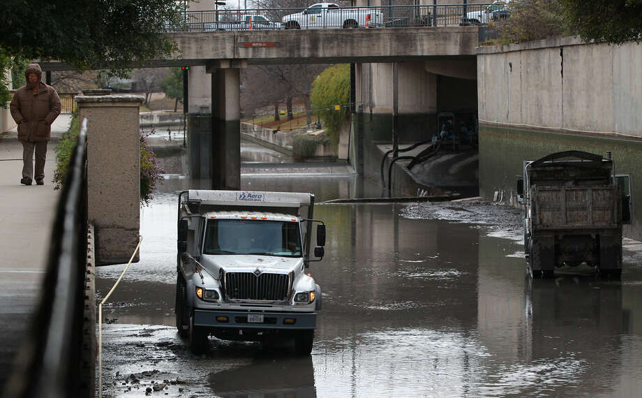 Crews have been cleaning the bed of the San Antonio River, last done in 2011. The river will be refilled by Sunday. Photo: John Davenport, San Antonio Express-News / ©San Antonio Express-News/Photo may be sold to the public