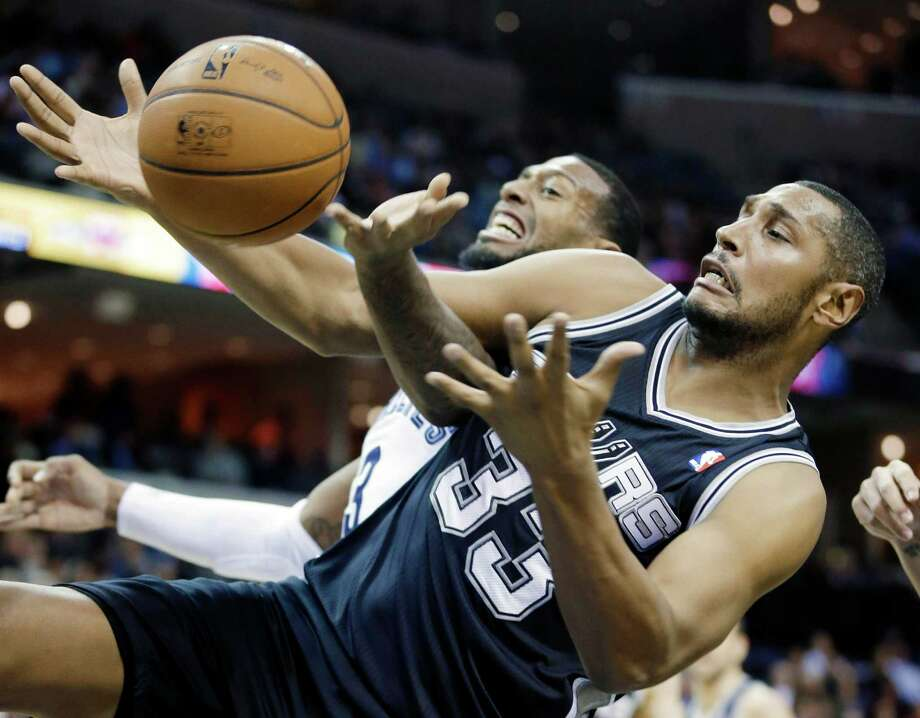 San Antonio Spurs' Boris Diaw (33), of France, gets a defensive rebound from Memphis Grizzlies' James Johnson in the first half of an NBA basketball game in Memphis, Tenn., Tuesday, Jan. 7, 2014. (AP Photo/Danny Johnston) Photo: Danny Johnston, Associated Press / AP