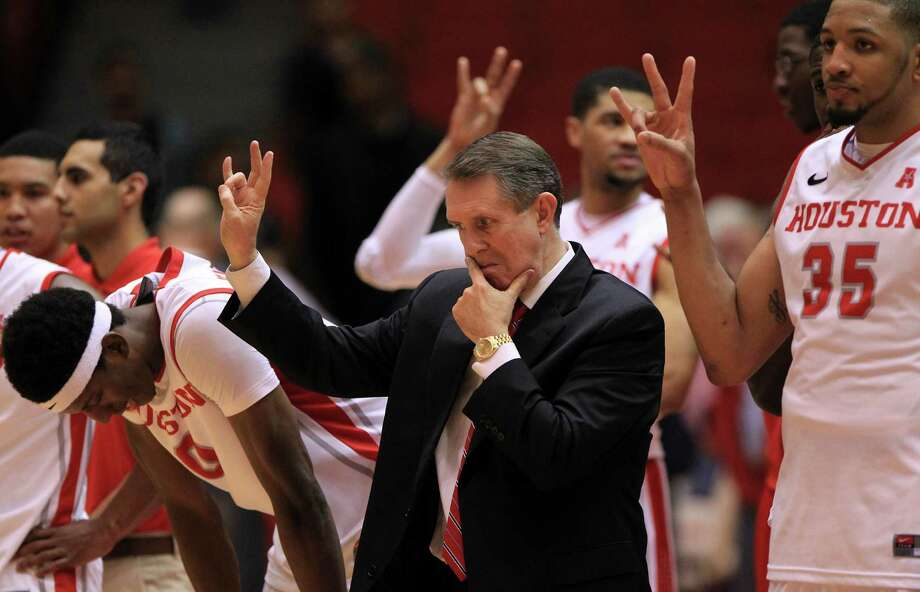 Houston Cougars coach James Dickey reacts after their 60-61 loss to Cincinnati Bearcats during the playing of the school song after a college basketball game at Hofheinz Pavilion, Tuesday, Jan. 7, 2014, in Houston. Photo: Karen Warren, Houston Chronicle / © 2013 Houston Chronicle