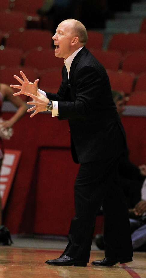Cincinnati Bearcats head coach Larry Davis yells during the second half of a college basketball game at Hofheinz Pavilion, Tuesday, Jan. 7, 2014, in Houston. Photo: Karen Warren, Houston Chronicle / © 2013 Houston Chronicle