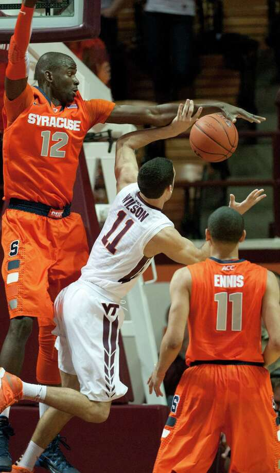 Syracuse's Baye Moussa Keita (12) blocks the shot of Virginia Tech's Devin Wilson during the first half of an NCAA college basketball game Tuesday, Jan. 7, 2014, in Blacksburg, Va. (AP Photo/Don Petersen) ORG XMIT: VADP106 Photo: DON PETERSEN / FR59093 AP