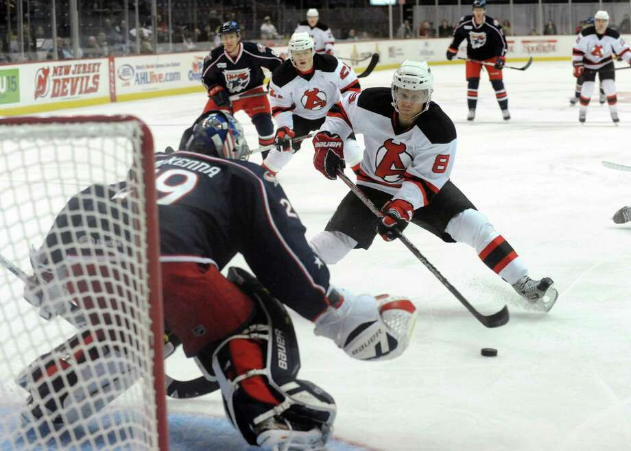 Devil's Mattias Tedenby goes in for a goal against Springfield goalie Mike McKenna during their hockey game at the Times Union Center on Tuesday Jan. 7, 2014 in Albany, N.Y. (Michael P. Farrell/Times Union) Photo: Michael P. Farrell / 00025270A