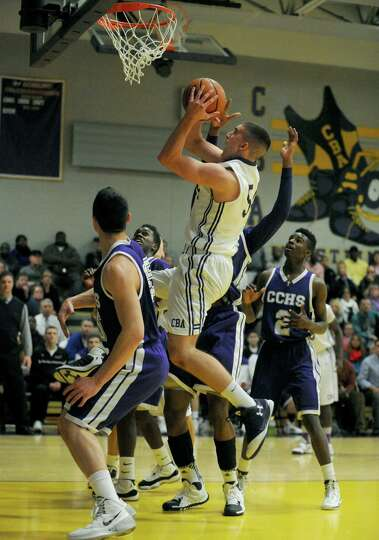 CBA's Greig Stire goes in for a score during their boy's high school basketball game against CCHS on