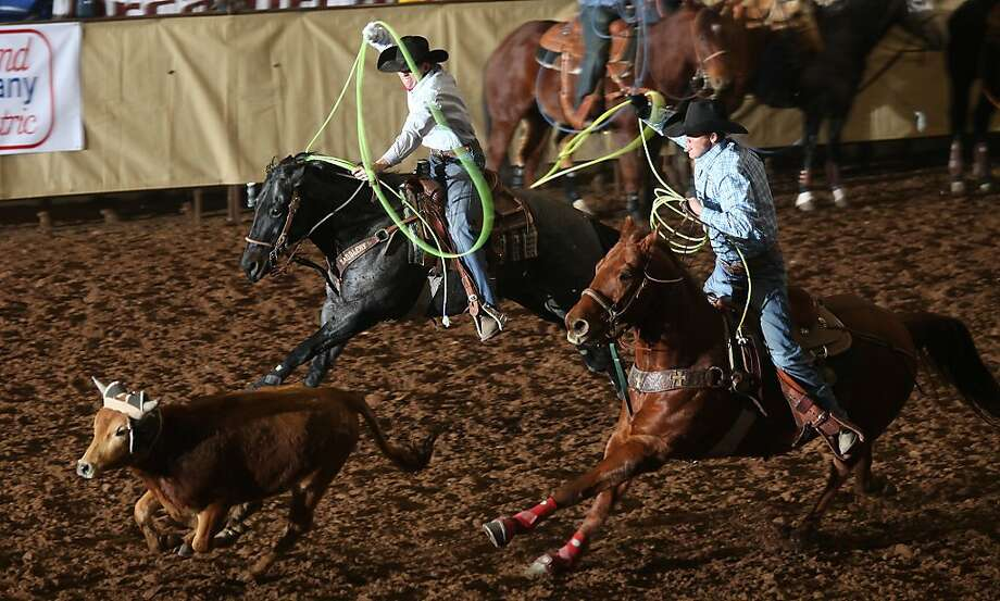 Cade Passig, left, and Chris Francis, both of Las Vegas, N.M., chase a steer during the 22nd Annual SandHills Invitational Team and Match Roping on Tuesday, Jan. 7, 2014 at the Ector County Coliseum in Odessa, Texas. (AP Photo/Odessa American, Ryan Evon) Photo: Ryan Evon, Associated Press