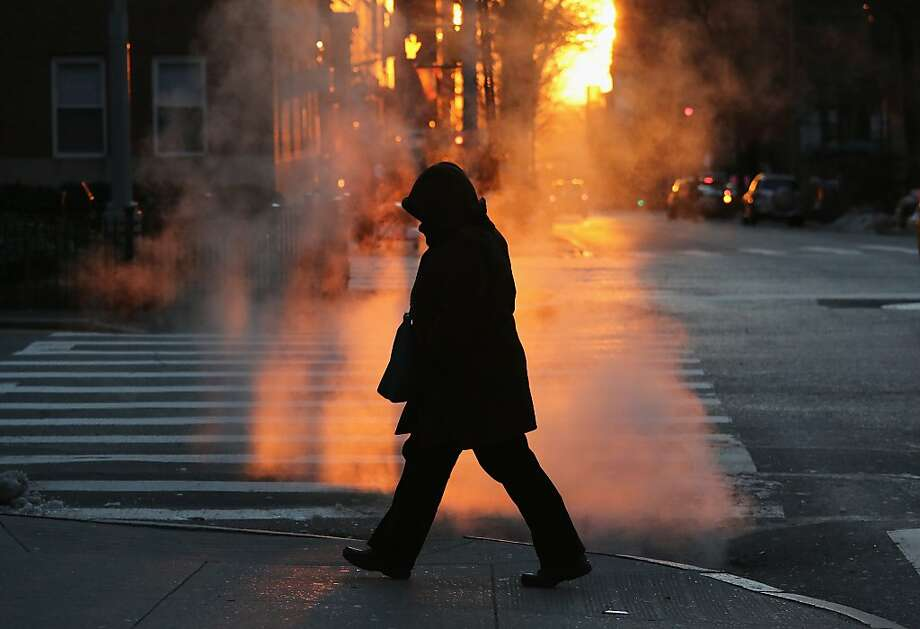 NEW YORK, NY - JANUARY 07:  A pedestrian braves the cold on January 7, 2014 in New York City. A 'polar vortex'  of frigid air centered on the North Pole dropped temperatures to a record low 4 degrees in New York City. (Photo by John Moore/Getty Images) Photo: John Moore, Getty Images