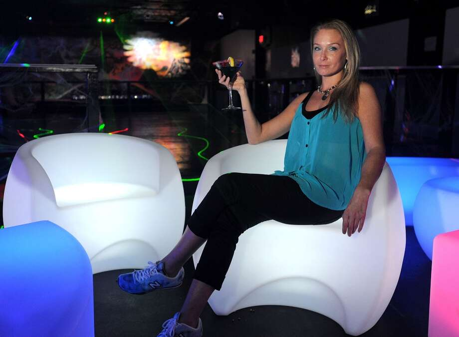 Kelly Armstrong holds a cotton candy martini at Club Heat.  Photo taken Wednesday, October 02, 2013 Guiseppe Barranco/The Enterprise Photo: Guiseppe Barranco/The Enterprise