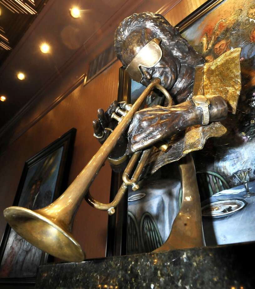 A statue of a jazz musician looks down onto the two large booths along the wall. Suga's is our Valentine's issue restaurant of the week.  Dave Ryan/The Enterprise Photo: Dave Ryan/The Enterprise