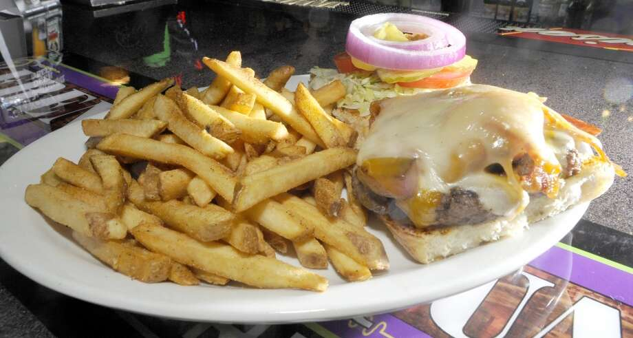 French Quarter Bar & Grill in Vidor is Aug. 22 restaurant of the week.  This is the stuffed cowboy burger platter. Dave Ryan/The Enterprise Photo: Dave Ryan/The Enterprise