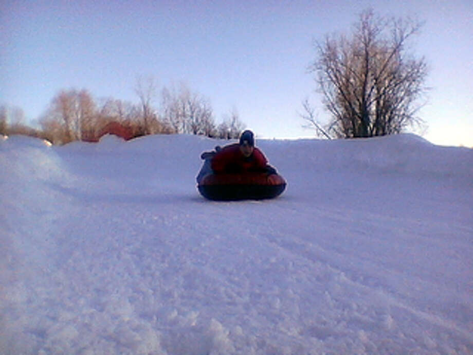 Go Tubing at Woodbury Ski Area 785 Washington Rd., Woodbury, CT 06798  The sport is simple, a blast and a great wintertime activity. Just hop onto an inflated tube and you're off. Woodbury Ski Area has 15 snow tubing runs offering almost a mile of tubing trails, three parks, and four lifts.
