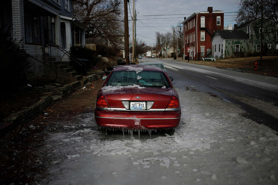 A sedan sits encased in ice after firefighters battled a nearby fire in bitter cold below-zero temperatures on January 7, 2014 in Louisville, Kentucky. Temperatures in the single digits coupled with below-zero wind chills have prompted the closure of local governments, schools, and businesses throughout the South. Photo: Luke Sharrett, Getty Images / 2013 Getty Images