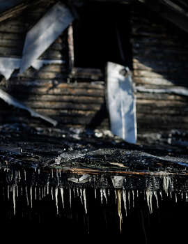 Icicles formed by water from fire department hoses hang from the charred remnants of 58-year-old Gerry Jennette's home in bitter cold below-zero temperatures on January 7, 2014 in Louisville, Kentucky. Firefighters blamed the blaze, which occurred last night, on a faulty space heater. Temperatures in the single digits coupled with below-zero wind chills have prompted the closure of local governments, schools, and businesses throughout the South. Photo: Luke Sharrett, Getty Images / 2013 Getty Images