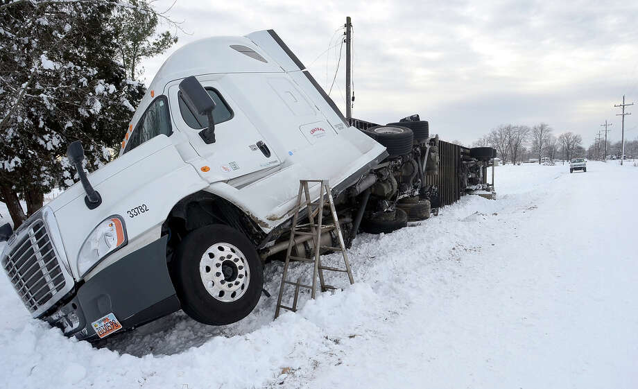 A semi tractor-trailer slid off the side of Indiana 42 in far eastern Vigo County, Ind. Tuesday afternoon, Jan. 7, 2014. The brutal polar air that has made the Midwest shiver over the past few days spread to the East and the Deep South on Tuesday, shattering records that in some cases had stood for more than a century. Photo: Jim Avelis, ASSOCIATED PRESS / AP2014